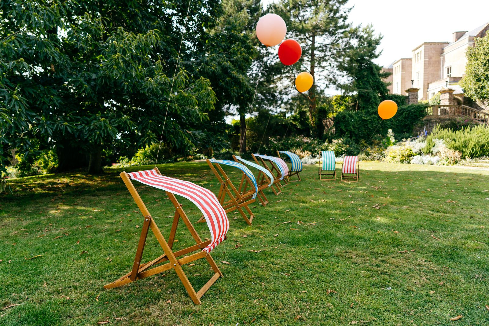 Deck chairs and balloons for outdoor entertainment at this Somerset wedding