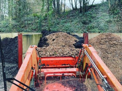 Composting at hestercombe claire greenslade digger in compost bays dec 2020